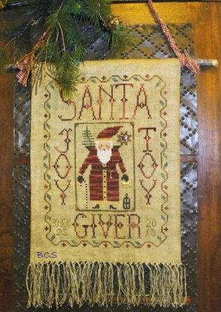 Homespun Elegance - Cinnamon Stick - Santa XXIV - Joy-Toy-Giver - Cross Stitch Pattern-Homespun Elegance, Cinnamon Stick,Santa XXIV, Joy-Toy-Giver, Santa Claus. toys, ornaments, Christmas, Cross Stitch Pattern