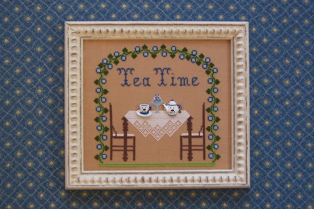 The Needle's Notion - Tea Time - Cross Stitch Pattern-The Needles Notion Tea Time Cross Stitch Pattern, table, trees, arbor, lace tablecloth, tea pot, tea cups,