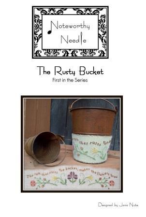 Noteworthy Needle -The Rusty Bucket-Noteworthy Needle -The Rusty Bucket, flowers, rain, gardening, weeds, cross stitch