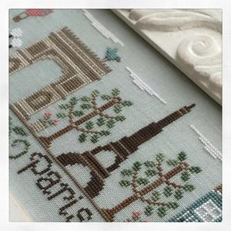 Country Cottage Needleworks - Afternoon in Paris-Country Cottage Needleworks - Afternoon in Paris - France, blue bird, Eiffel Tower, hot air balloons, Cross Stitch Pattern