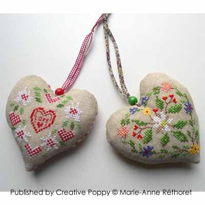 Creative Poppy - Marie-Anne Rethoret-Melin - Cowbell Hearts-Creative,Poppy,Marie-Anne,Rethoret-Melin, Cowbell,Hearts,Cross,Stitch,Patterns,hearts, bells, mountain pasture, flowers, edelweiss, summer