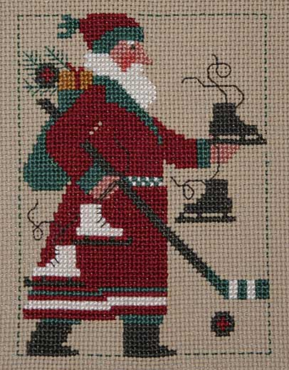Prairie Schooler - 2009 Santa-Prairie Schooler, 2009 Santa, skating Santa, Hockey Santa, bag of toys, Santa Claus, Cross Stitch Pattern