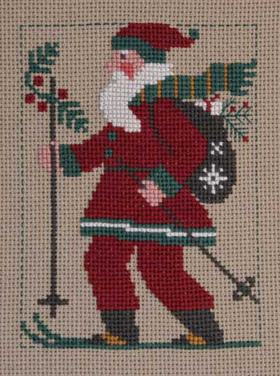 Prairie Schooler - 2010 Santa-Prairie Schooler, 2010 Santa, skiing Santa, holly, bag of toys, santa claus, Cross Stitch Pattern